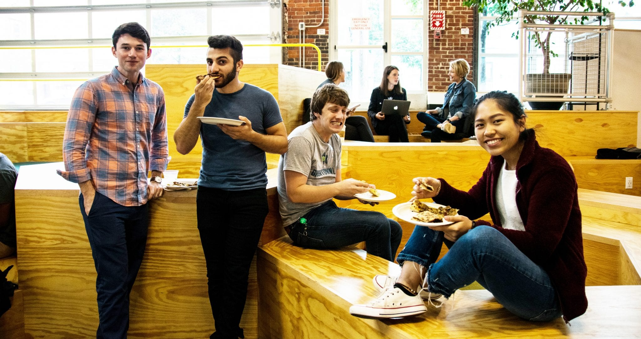 greentown tufts students smiling and eating